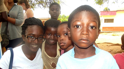 Precious (left) with kids in her Accra, Ghana neighborhood