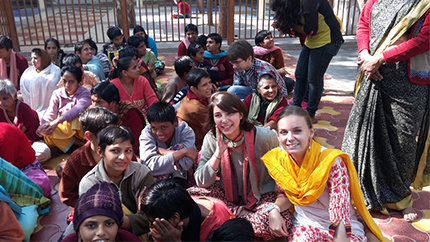 Carolyn (in yellow) poses with some new friends she made in India
