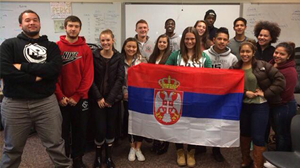 Serbian exchange student Dunja Paunovic poses with the Serbian flag and her new friends at her host school in Seattle, Washington.
