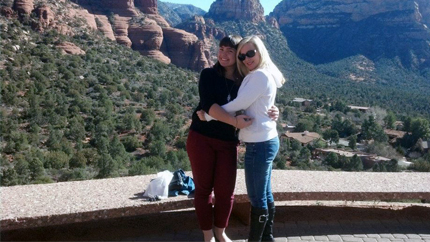 Claire (right) and FLEX student Anna pose together in front of the Sedona Red Rock Mountains. Photo courtesy of Claire Mattern.