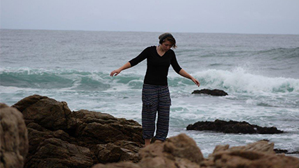 Erica walking near the surf in South Africa.