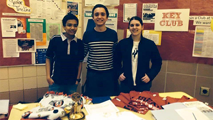Ion (center) poses with two other Key Club volunteers