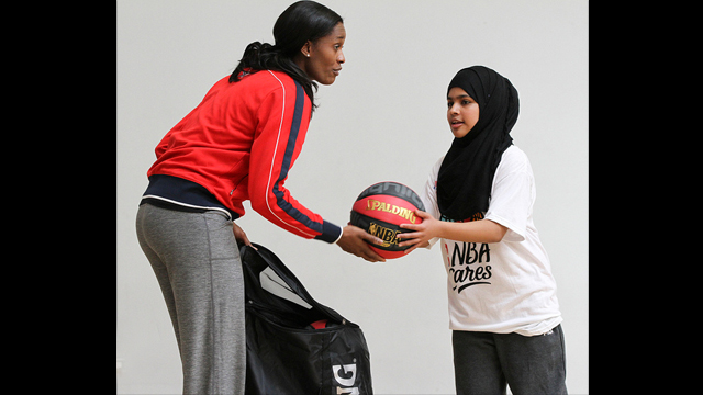 Swin Cash works with a teenage girl in London.