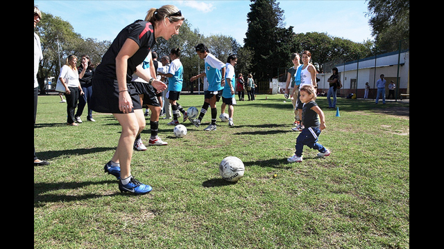 A participant's little sister joined in to learn some soccer skills.