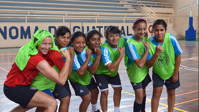 The Guatemalan soccer girls pose with Tracy Noonan.