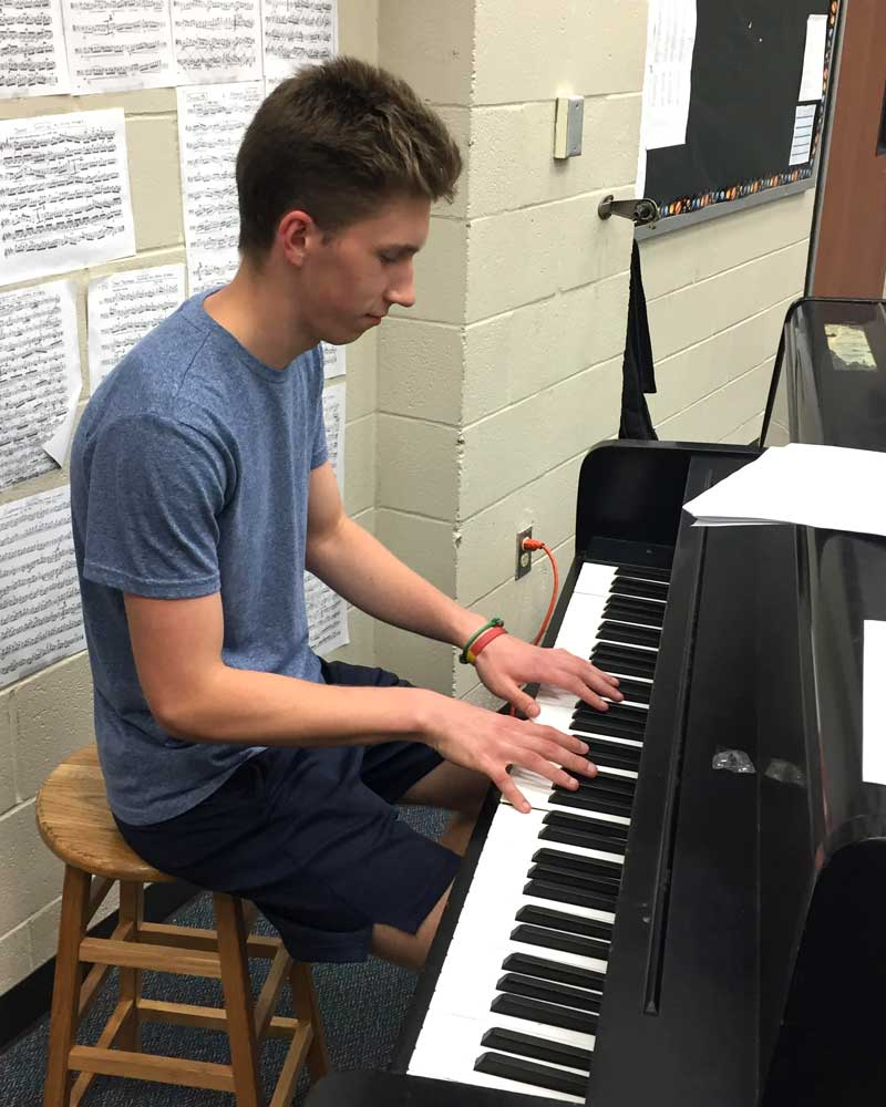 Young man playing a piano