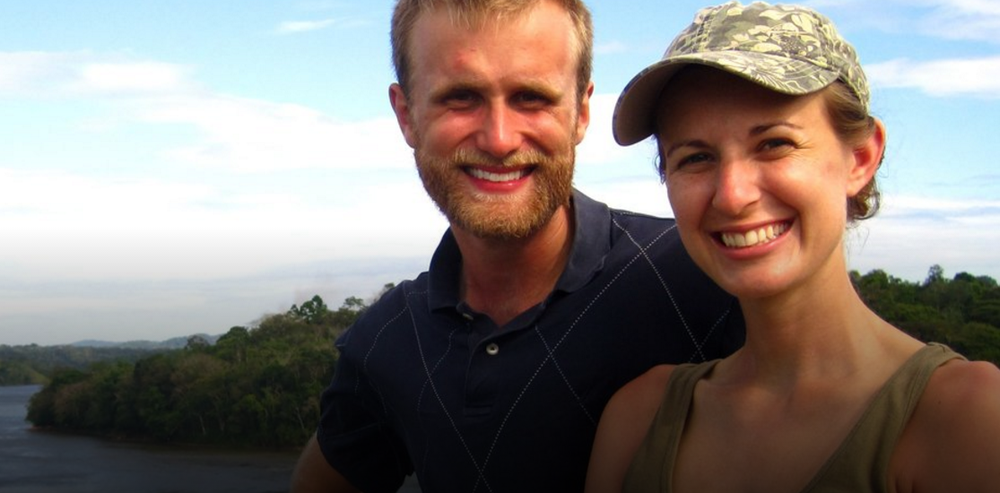 Couple smiling with beautiful landscape in the background