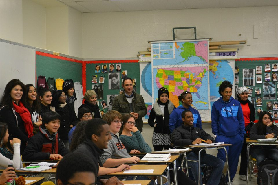 The group attends a high-school history class to learn about the U.S. school system.