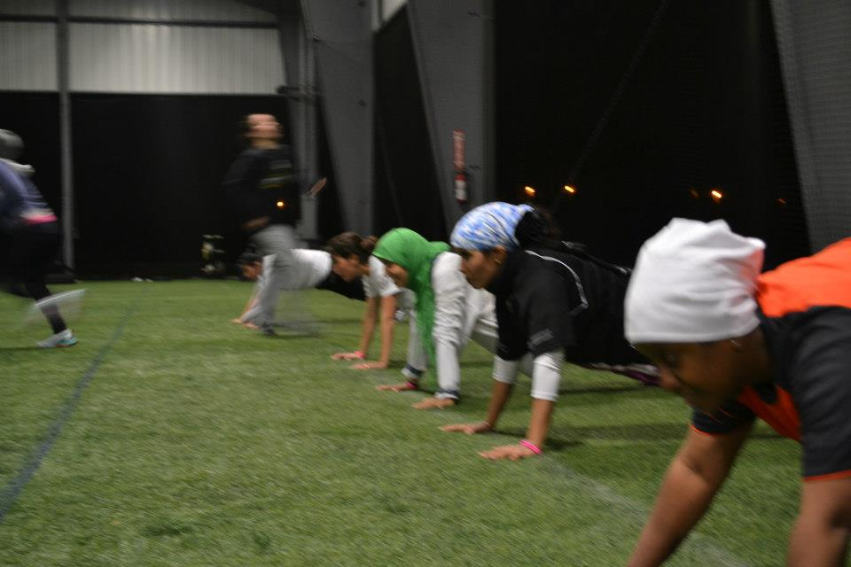The volleyball coaches from the Gulf Nations stay strong throughout a challenging workout.