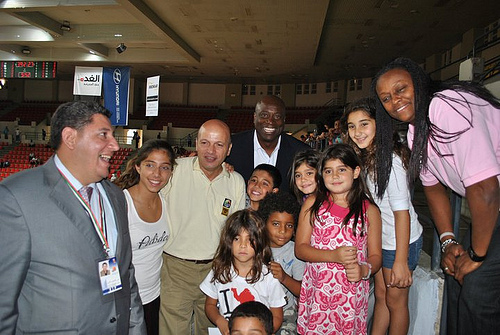 Andrea Stinson and Sam Vincent pose with young Jordanian fans.