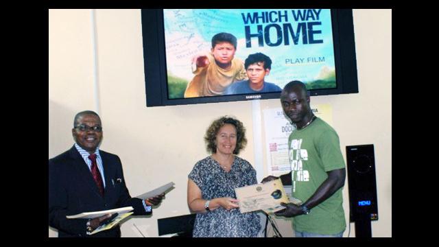 Filmmaker, Kim Snyder, presents a certificate to a Nigerian workshop participant.