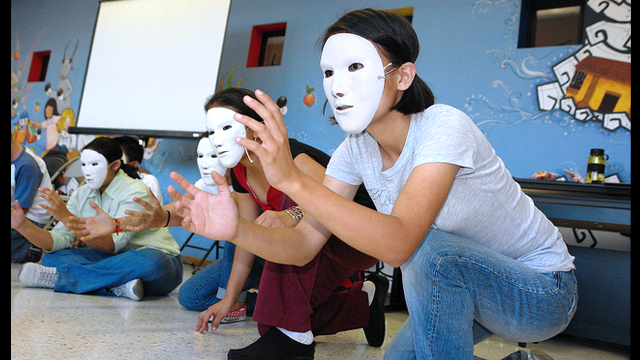Theater workshop participants in San Salvador explore their creativity.