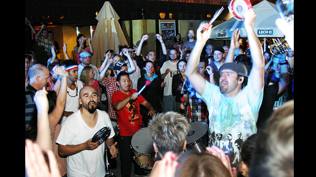 Ozomatli band members join the crowd at Herbert Hoover Square in Warsaw, Poland.