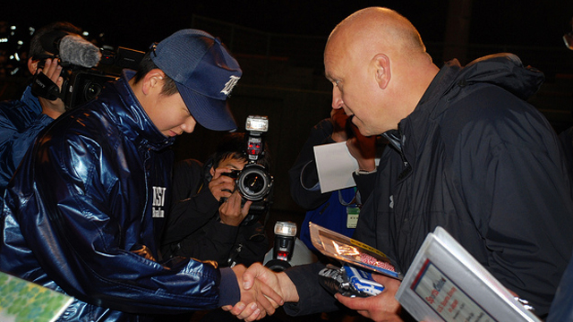 Cal Ripken visits a former participant from a State Department sports exchange program.
