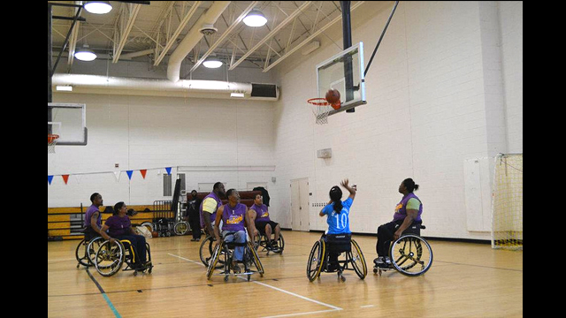The group participates in a wheelchair basketball game during a session in Washington, D.C.
