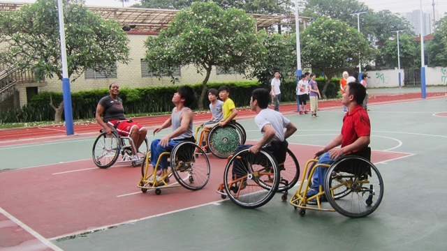 Students at Peiying Vocational School play wheelchair basketball with Sports Envoy Dr. Woodson-Smith.
