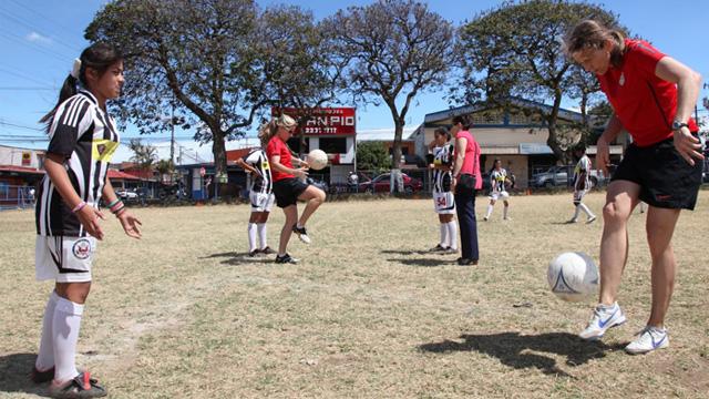 The envoys instruct participants on footwork techniques.