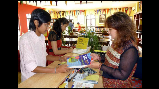Advisers in Nepal help students prepare for the Scholastic and Aptitude Test (SAT).