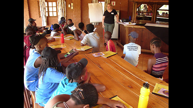 An English Language Fellow facilitates a session at a summer camp in South Africa.