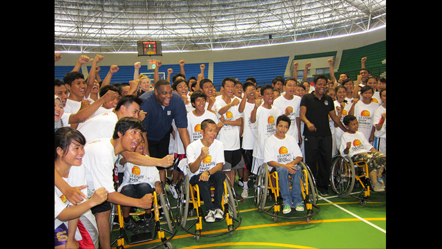 Rick Mahorn and Edna Campbell at a wheelchair basketball coaching clinic with young Indonesians from the Yakkum Rehabilitation Center.
