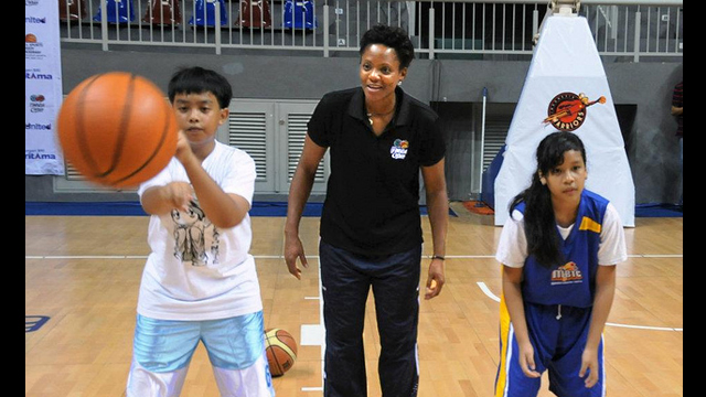WNBA Champion Edna Campbell focuses on hand-eye coordination drills with young players during a clinic.