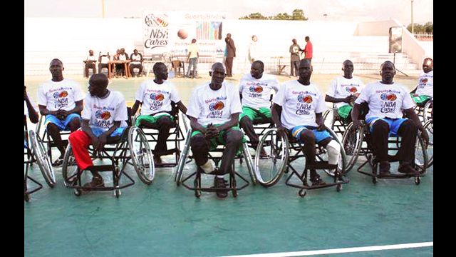 The South Sudanese wheelchair basketball team poses for a photo.