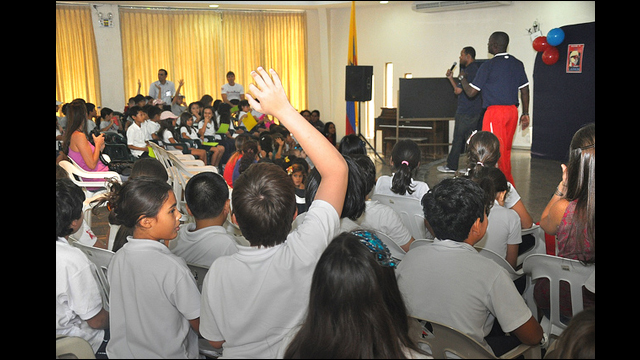 Barry Larkin and Joe Logan interact with girls and boys at Colegio Americano in Ecuador.