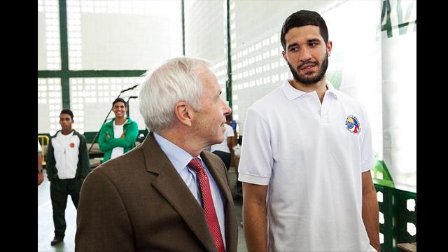 After the opening event, Charges d'Affaires, James Derham, converses with Venezuelan national sports hero, Greivis Vasquez.