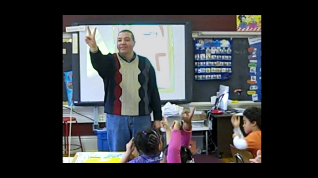 Ahmad Eleraky teaching Arabic at Pratt Community School in Minneapolis, Minnesota.