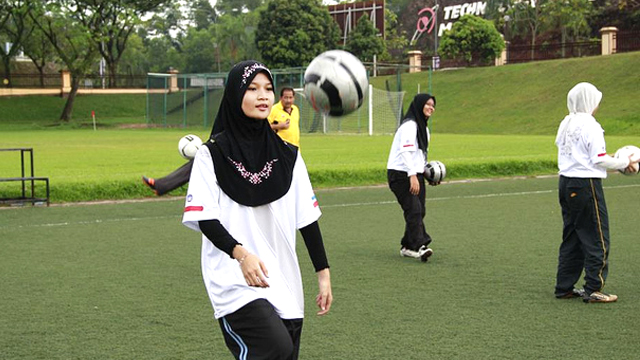 A young Malaysian athlete works on her ball handling skills during a clinic in Kuala Lumpur.