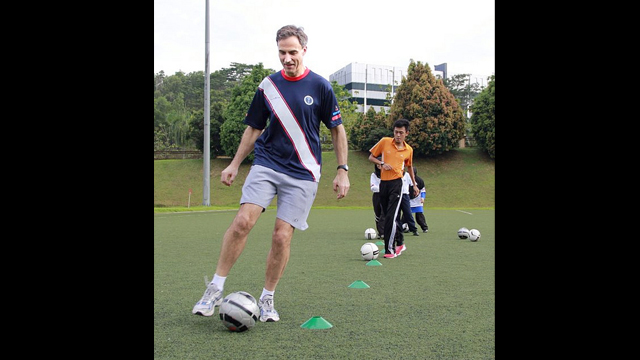 U.S. Ambassador to Malaysia, Paul Jones, shows off his footwork in a soccer clinic.