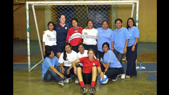 Soccer Envoys Tracy Noonan and Shannon MacMillan pose with girls in Solala, Guatemala.