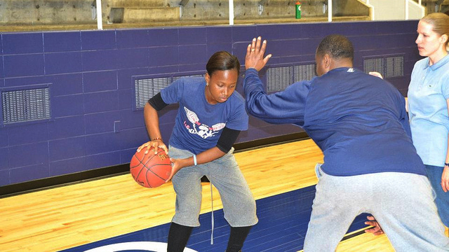 The young athletes from the DRC participate in dribbling drills at a Howard University Clinic