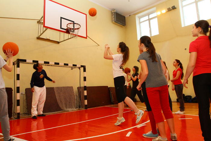 A young Ukrainian female launches a shot during practice.