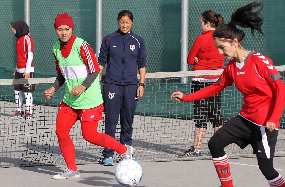The participants do drills with Sports Envoy Lorrie Fair at the U.S. Embassy Kabul.
