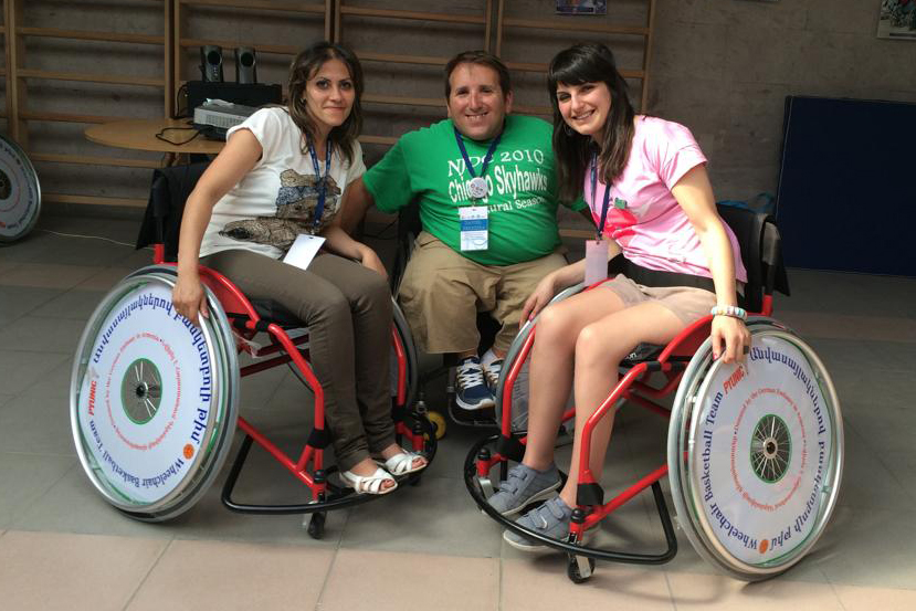 Armenian participants who will visit the U.S. in September 2014 experience sport-wheelchairs with an American participant.