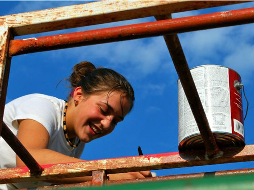 An A-SMYLE student helps improve a local playground as a community service project.
