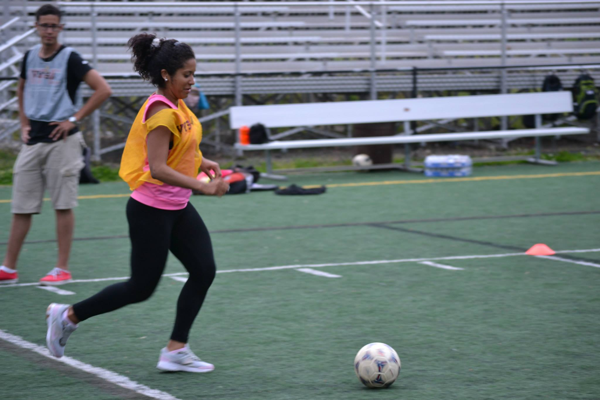 A sports visitor running down the ball during a drill
