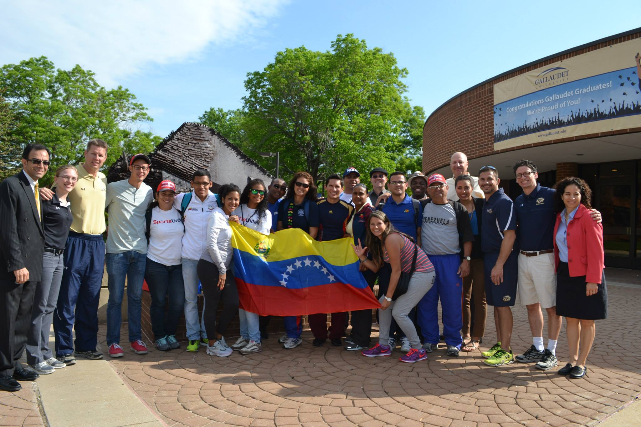 The group poses for a photo before they begin their meetings at Gallaudet University