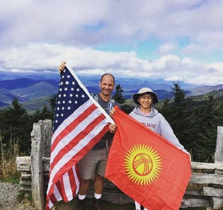 Meder holding flag with host dad