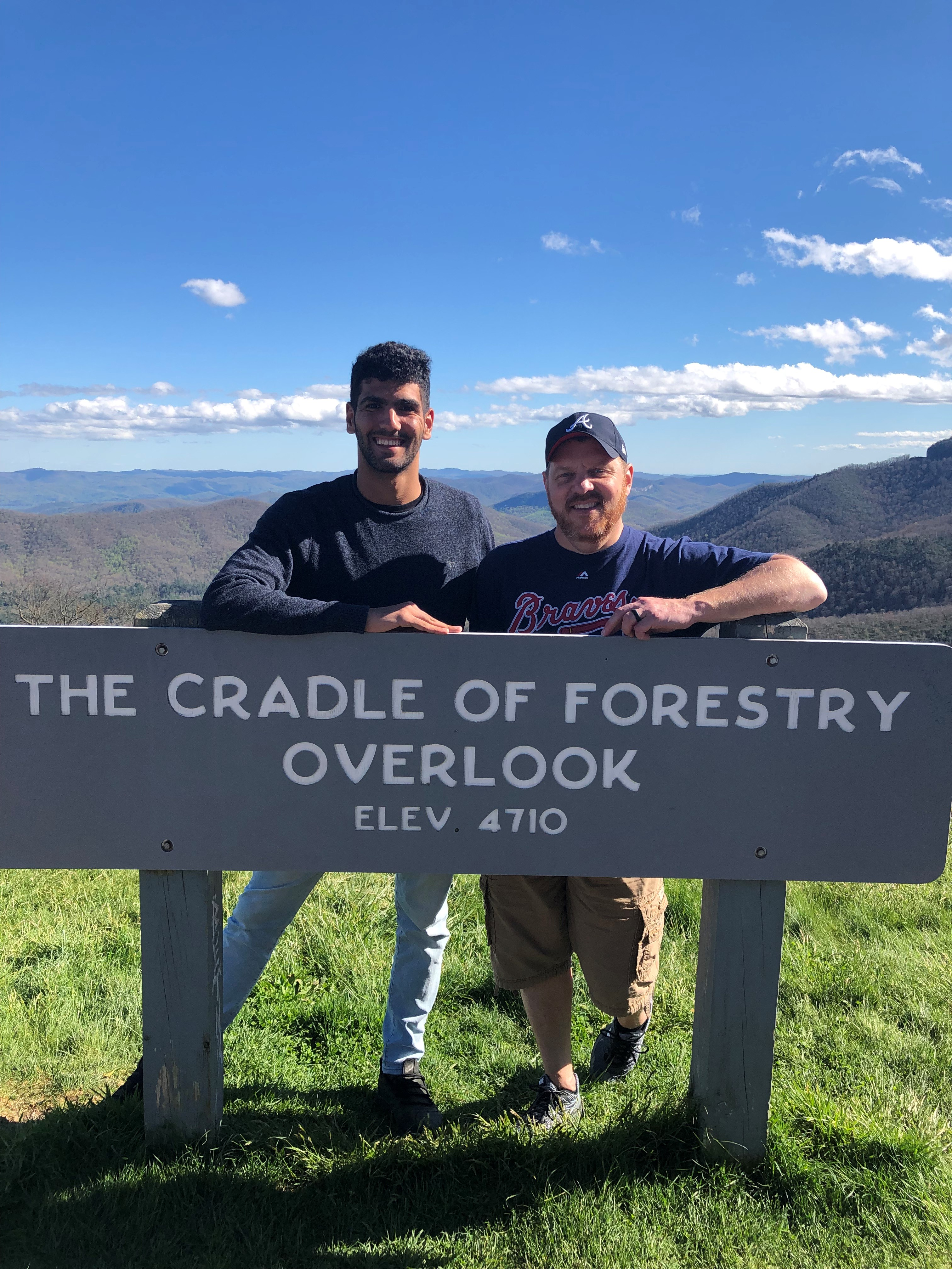 Ouail with host dad hiking at cradle of forestry overlook