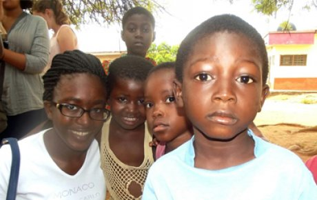 Precious (left) with kids in her Accra, Ghana neighborhood