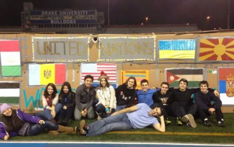 Group of students pose on the infield of the Drake University track
