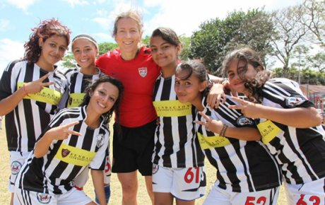 Tracy joins the girl Costa Rican soccer players.