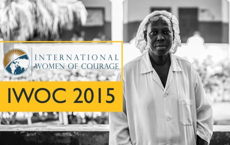 "Woman appears to be in factory wearing hair net with title overlay that reads ""International Women of Courage IWOC 2015"""