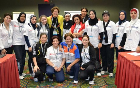 The delegation poses with Kathy DeBoer of the American Volleyball Coaches Association after a session on gender and competition.