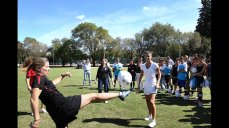 Former U.S. Women's National Team star Amanda Cromwell demonstrates a kick for the young players in Argentina.
