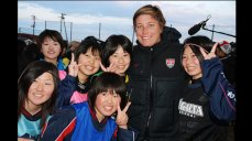 U.S. soccer forward, Abby Wambach, meets some potential future members of Japan's national soccer team.