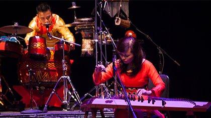Phạm Trà My, đàn tranh (16 string zither), and Hà Đình Huy, drums and percussion, of the Trí Minh's Quartet perform at the Kennedy Center's Millennium Stage.