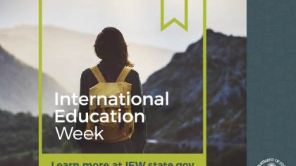 Woman wearing backpack faces mountain and graphic overlay reads: International Education Week